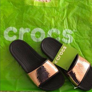 CROCS women's sandals. Black & hammered rose gold.